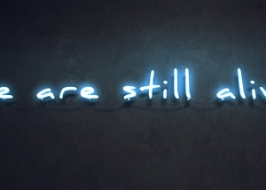 we are still alive W800 300x214 - Neon